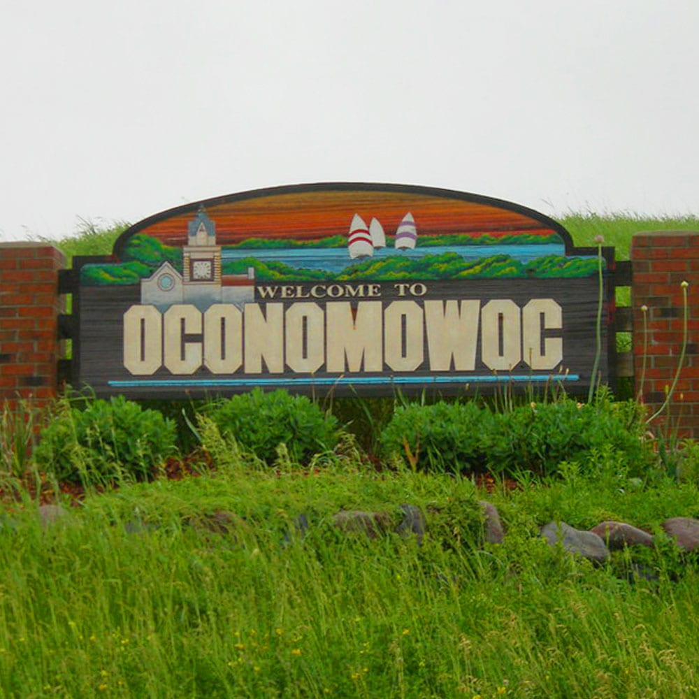 Welcome To Oconomowoc sign