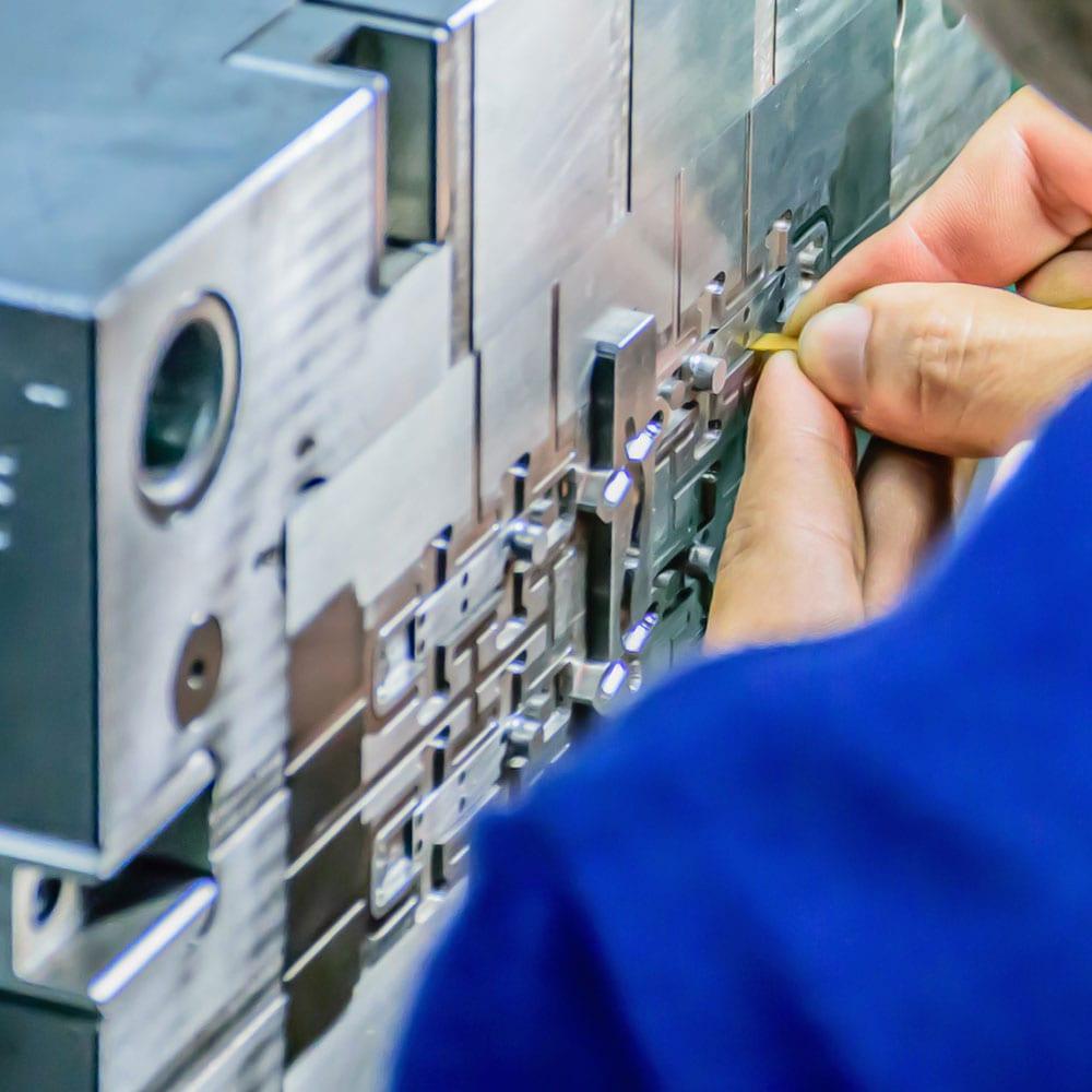 man fixing machine